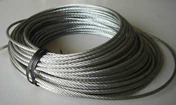 A coil of fully lubricated bright steel wire rope is placed on the ground.